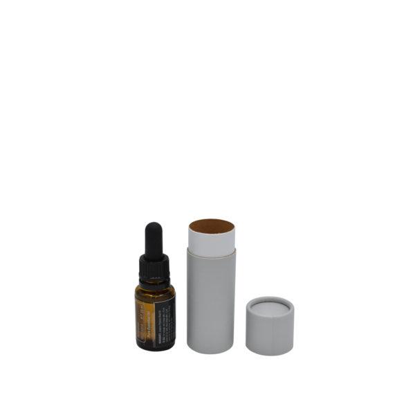geöffnete betubed Pappdose lichtgrau, daneben ein Ölfläschchen